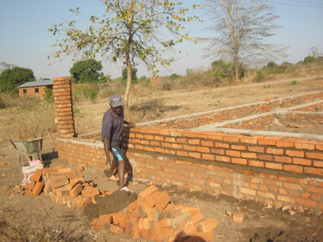 One of the workers building up the office wall.