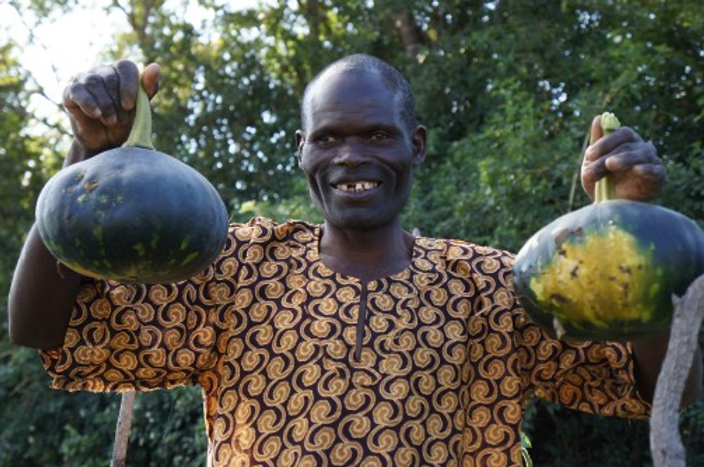 McDonald used his Small Business Fund grant to purchase a treadle water pump, to replace the watering can for irrigating his farm. His grandchild had died just days before our visit and so we took time to pray with him after admiring his tomato, mustard greens, and squash crops.