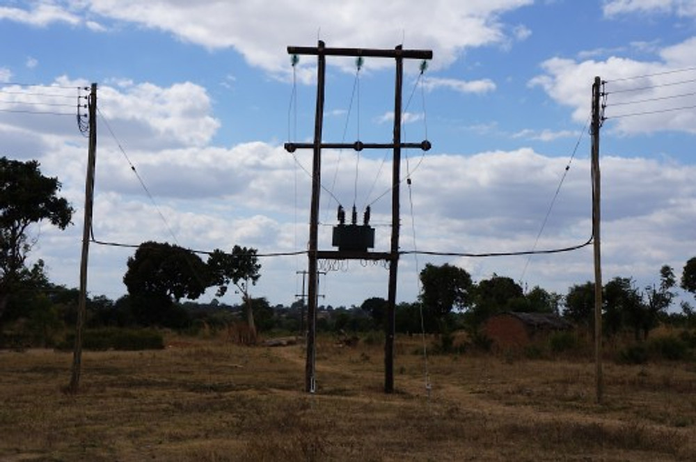 One of the first electricity towers in Manyamula Village. July 2014.