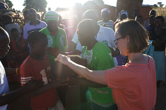 Blessing a Pig in Malawi