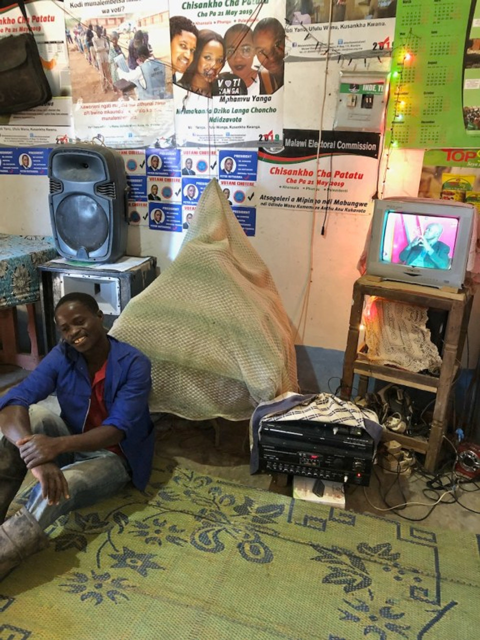 man posing with TV and radio system