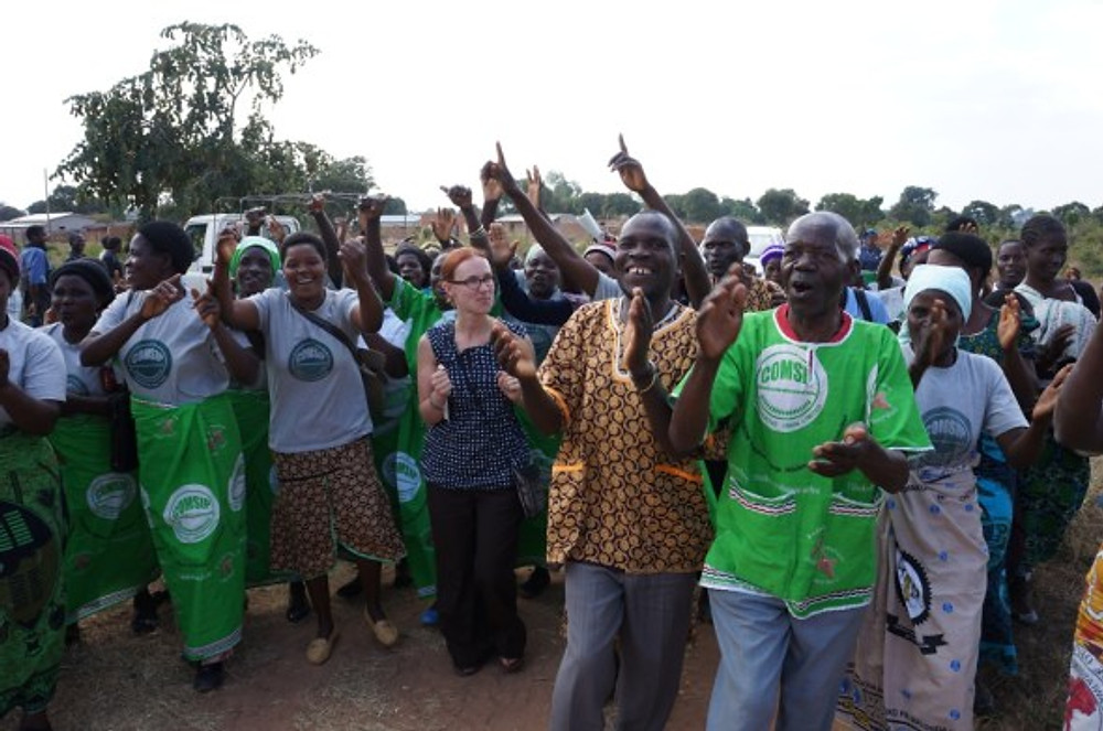Manyamula COMSIP Cooperative members sing a song of welcome. (Malawi, 2014)