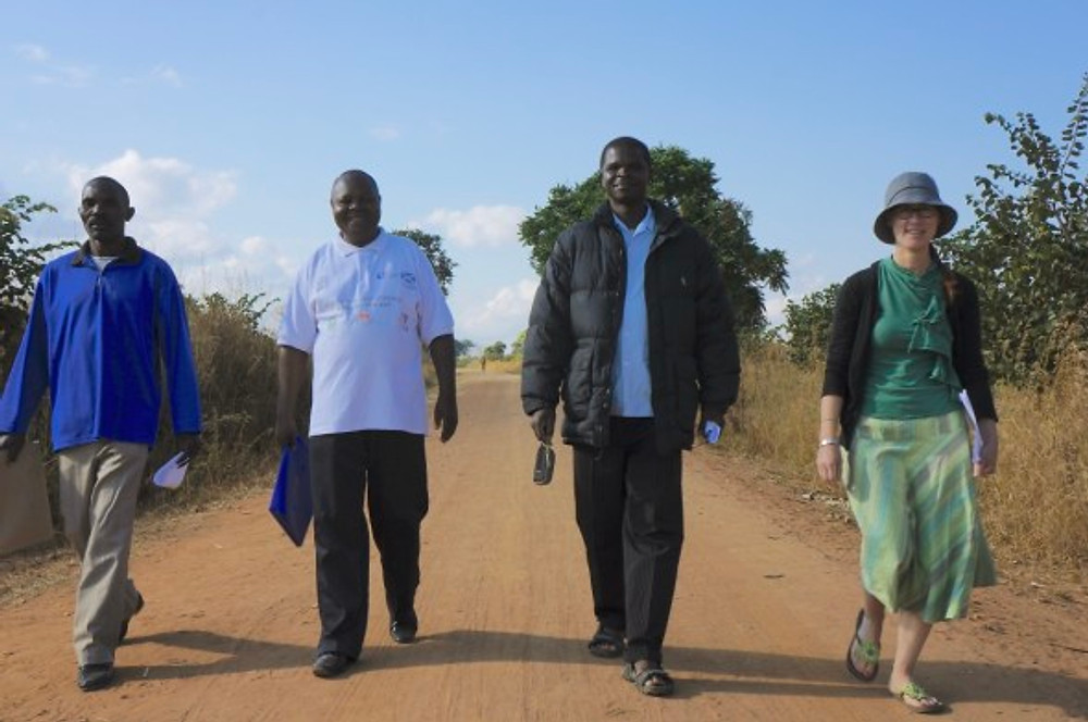 I love this movie poster like photo! Can you tell we mean business? Slyvestor, Canaan Gondwe, Winkly Mahowe, walking with me down the dusty road in Manyamula on the way to our site visits.
