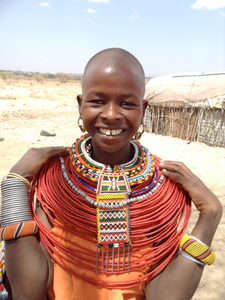 Young artisan showing off the beautiful beaded jewelry.