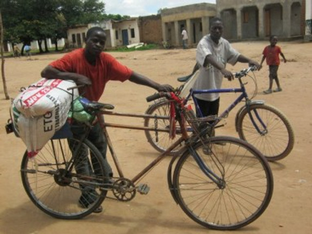 People hire bicycle ferries to ride across town (sitting on the back of the bikes) or carry goods like fertilizer and crops to/from market. The rough roads are hard on the tires.