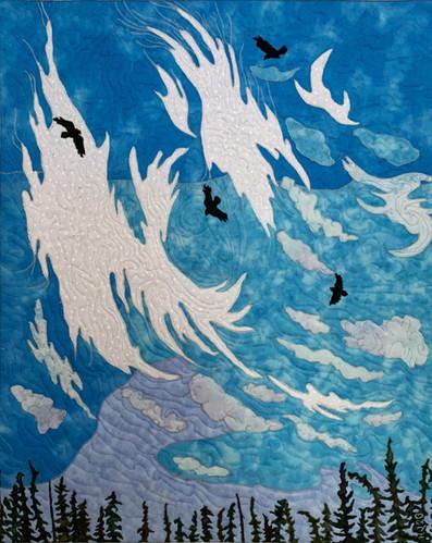 """Cirus Clouds and Ravens"" 2020. Hilary Johnstone 19"" x 23"". fabric, thread, batting. Can be purchased through Handmade House Gallery, Saskatoon, SK."