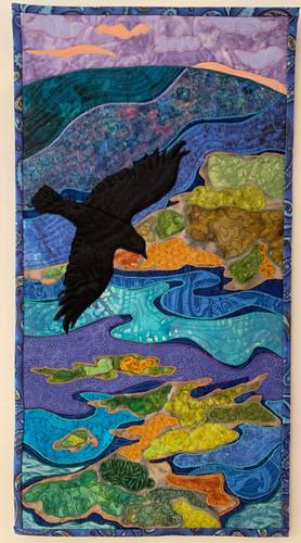 """Raven, Lake, Islands"", 2021, Hilary Johnstone, fabric, thread, needle point batting, (Can be purchased through Handmade House Gallery, Saskatoon,SK.)"