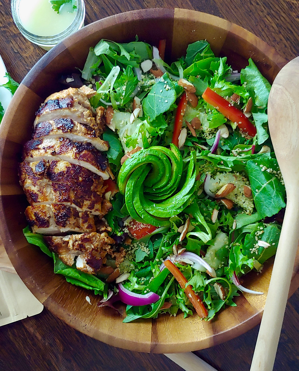 Pan seared chicken breast with a tandoori dry rub served with an avocado salad