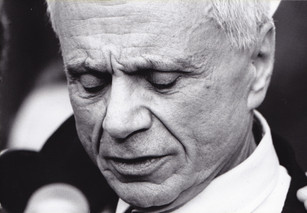 A deep mask of exhaustion and joy embrace Robert Blake's face as he nearly faints while standing for the press conference, a short time after his innocent verdict was declared.