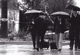 A rainy day for Robert Blake as umbrella wielding lawyers escort their client to court.