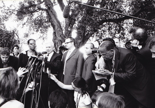 A swelling press corps and defense team shares the stage with Blake during his exoneration speech.