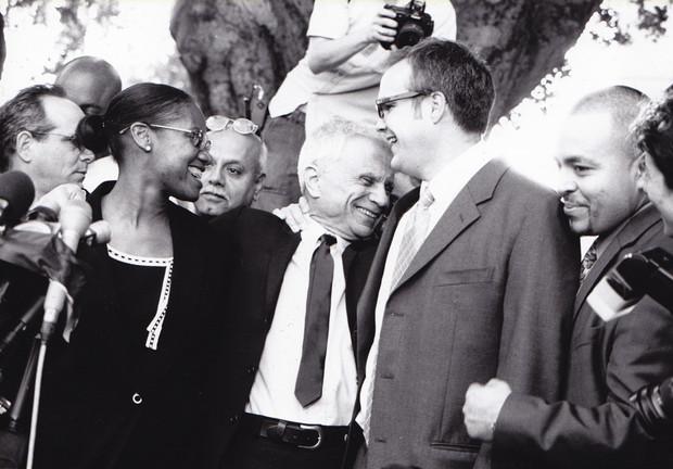 Robert Blake, (center), enjoys the splendor of his victory amid throngs of camera and press.
