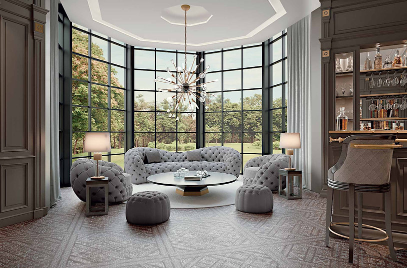 Mother and daughters sitting on a grey sofa in a bright luxury living room