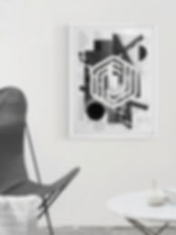 shapeshift chair and art wall and small white table