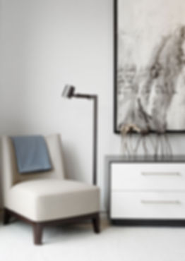 grey and brown chair in a room corner