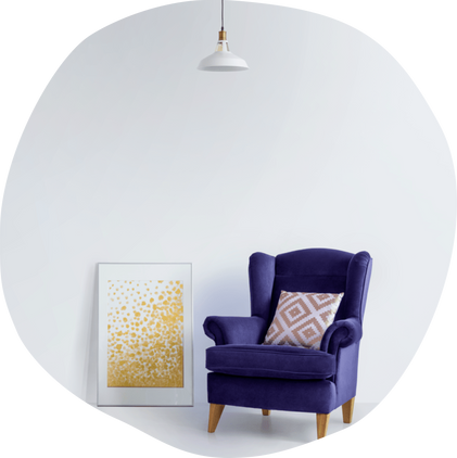 purple chair with grey wall in background