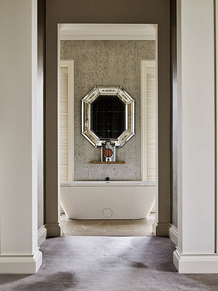 Luxury white and brown bathroom with a gold mirror