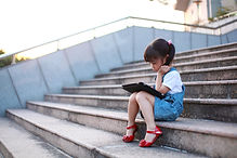 Cute-girl-playing-with-a-tablet-computer