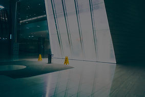 yellow-wet-floor-signages-near-glass-wal