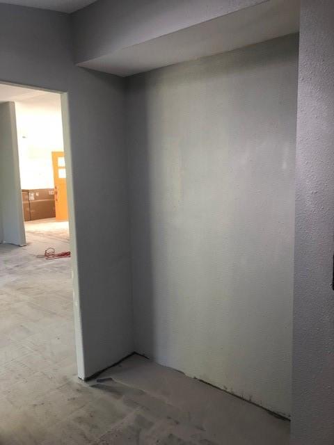 Mud room sitting area before