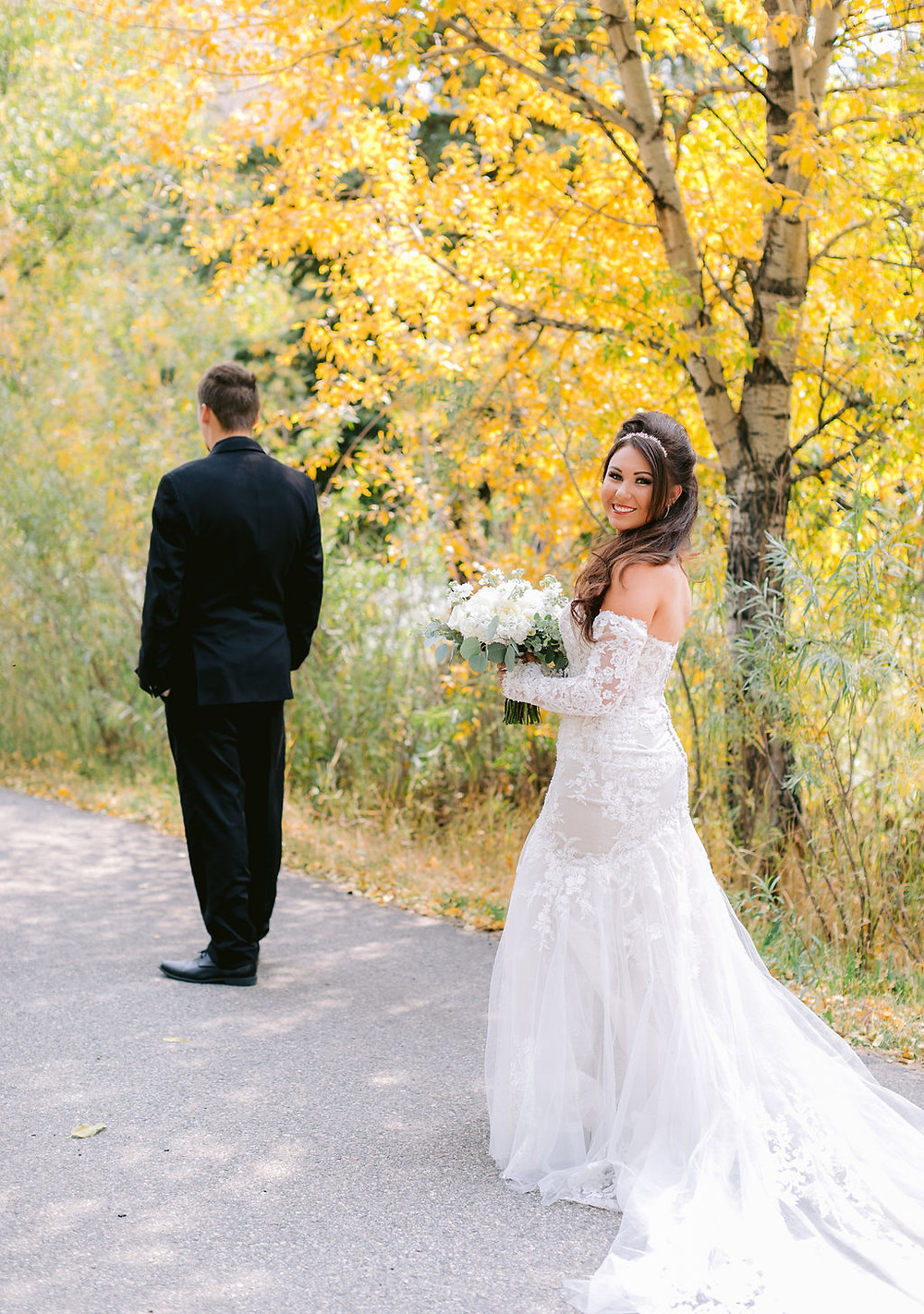 Vail Wedding at the Golf and Nordic Center. Vail Mountain top wedding pictures. Destination micro wedding. Gold and green and white wedding. First look.