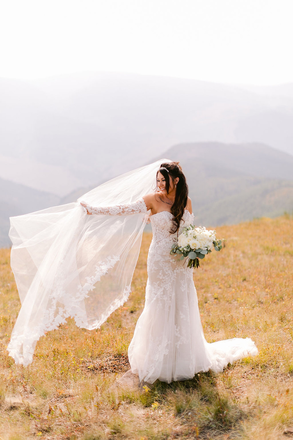 Vail Wedding at the Golf and Nordic Center. Vail Mountain top wedding pictures. Destination micro wedding. Gold and green and white wedding.