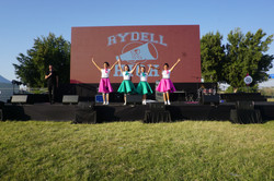1950's group on stage w backdrop (1)