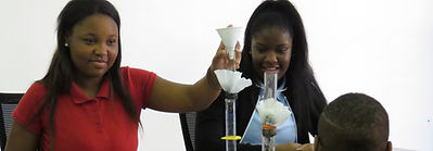 Students performing a science experiement