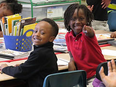 3rd graders smiling for the camera.
