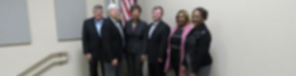 BCSD Board Members standing in front of American flag.