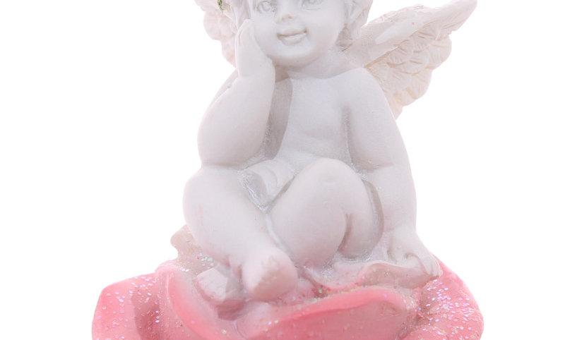 Cherub sitting in a Rose Bud