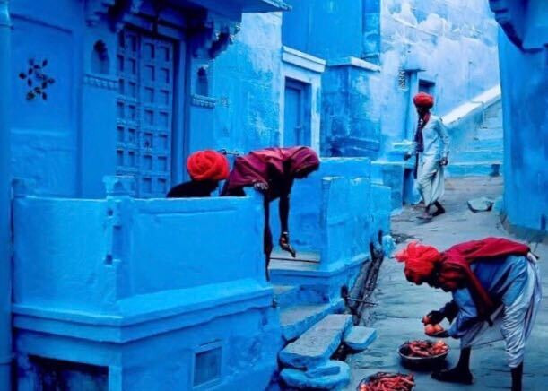 Houses painted with vibrant blue color