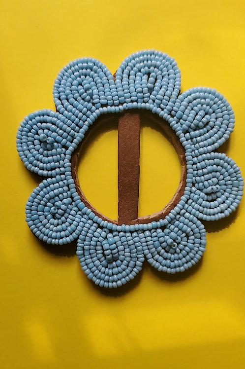 Beaded leather buckle