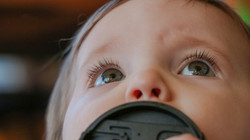 Eyes of one-year-old looking up at sky
