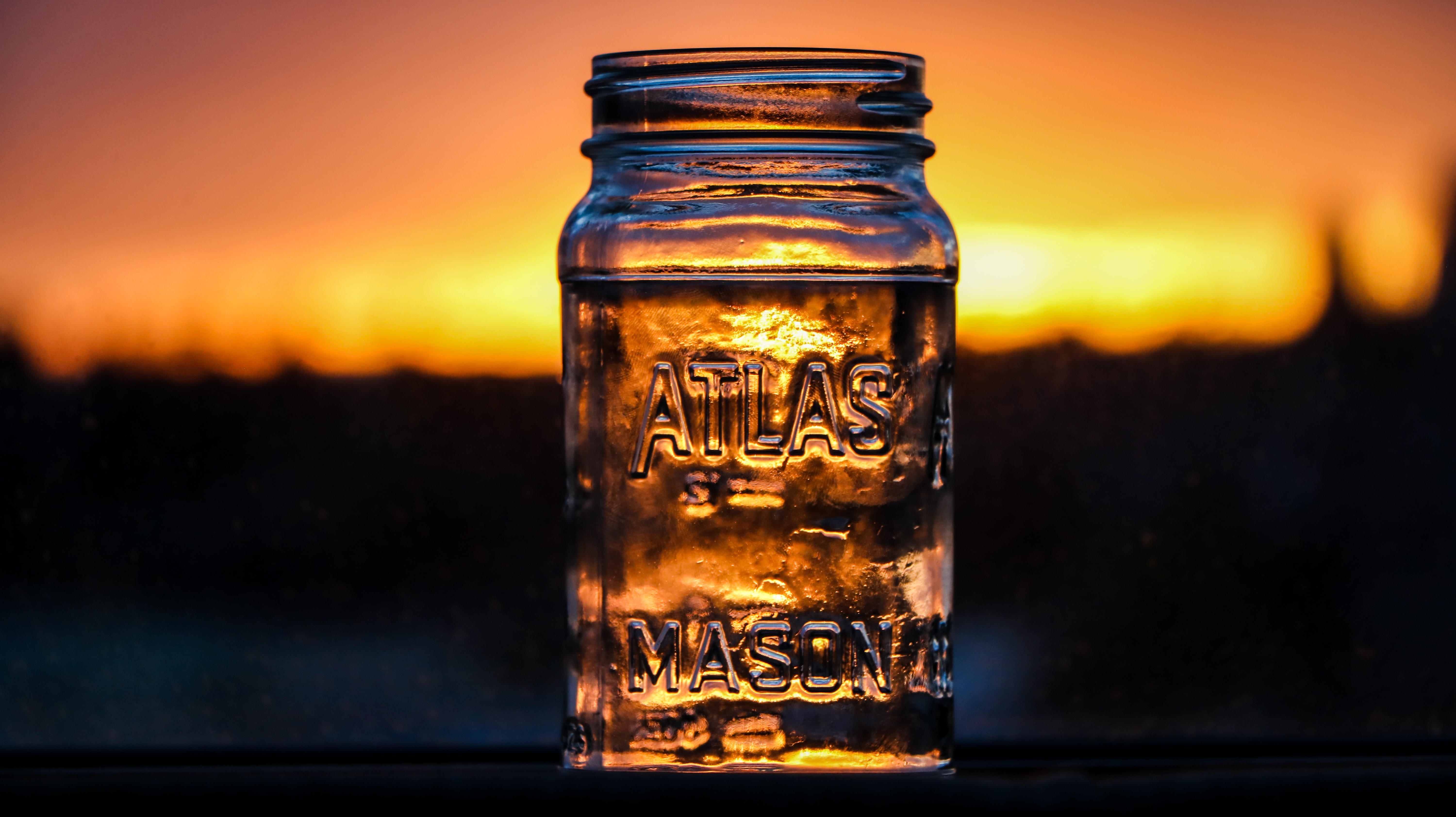 Mason Jar at sun set.