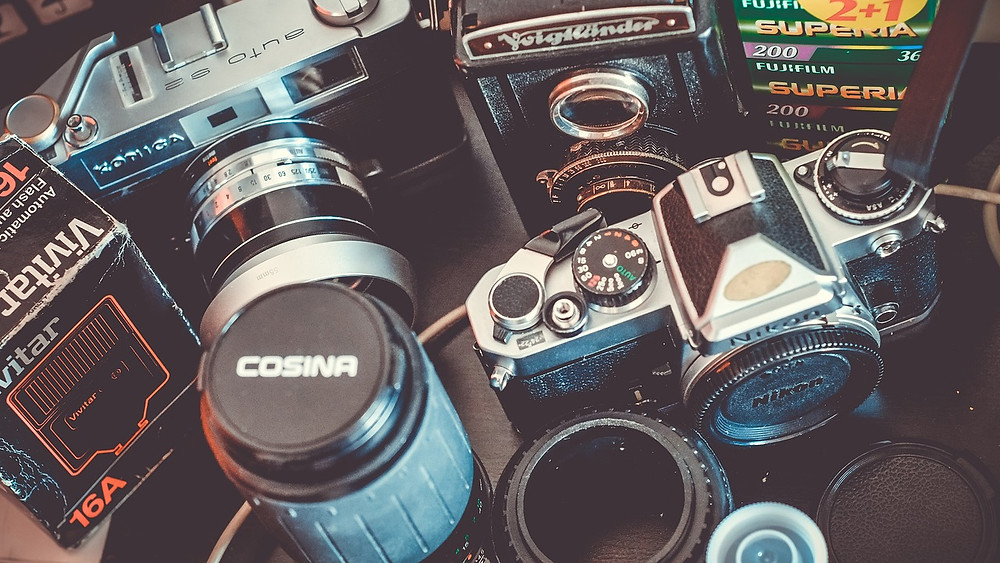 A collection of vintage cameras and lenses