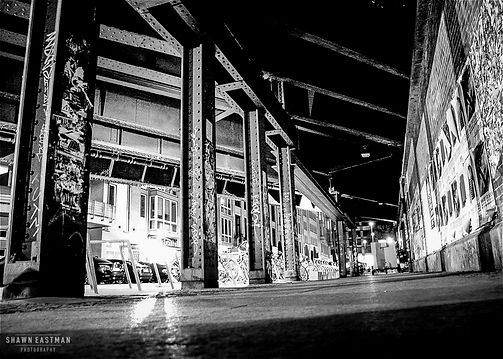 Black and white street photograph night shot of a scene in Berlin, Germany