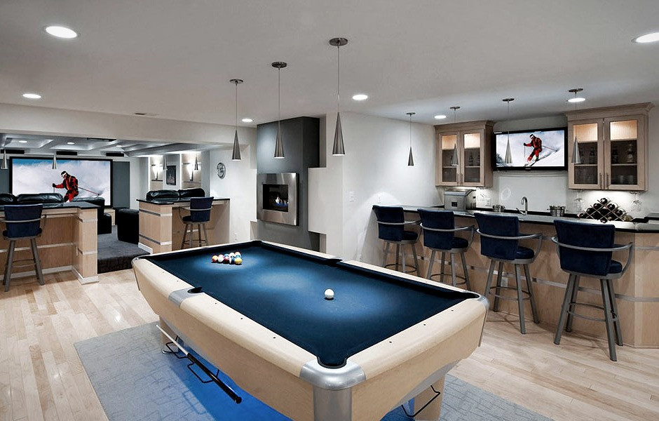 Man cave in a basement conversion inside a property in Cardiff, South Wales, with pool table and bar area