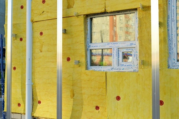 Hollow wall insulation and double glazed windows being installed on a property in Cardiff, South Wales