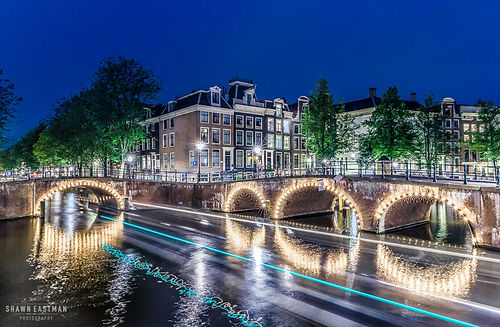 Nighttime long exposure photograph of the Keizersgracht canal in Amsterdam, the Netherlands