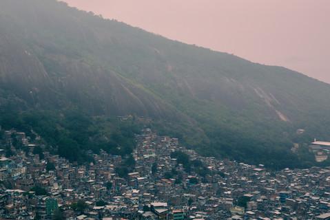 misty-sunset-over-rocinha-favela-rooftop