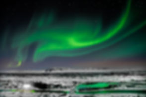 Nighttime long exposure photograph of the Aurora Borealis (the Northern Lights) in Iceland