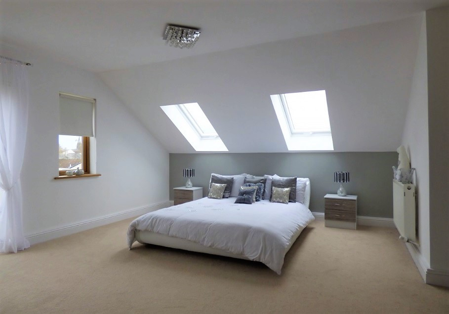 A loft conversion with a kingsize bed in a property in Cardiff, South Wales