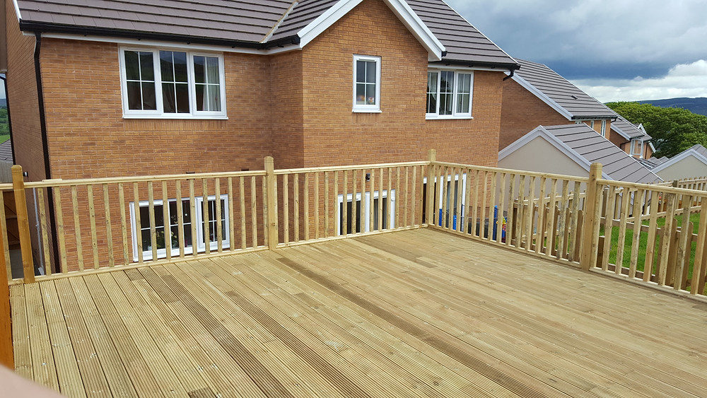 A wooden decking area in the garden of a property in Cardiff, South Wales