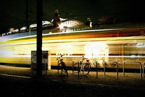 train-passing-through-station-night-berl