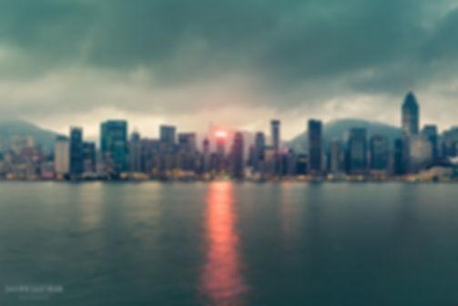Landscape photograph of the Hong Kong skyline before sunrise