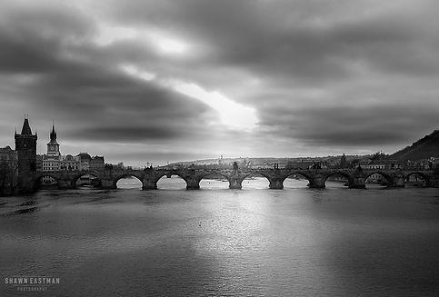 Black & white landscape photograph of the Charles Bridge in Prague, Czech Republic