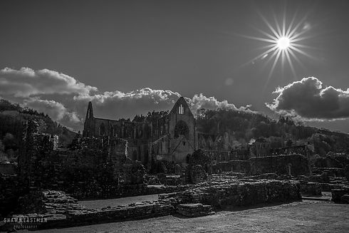 Black and white landscape photograph of the Tintern Abbey in Monmouthshire, Wales, United Kingdom