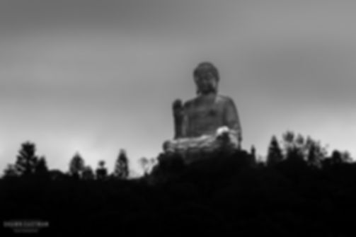 Street photograph of a the Tian Tan Buddha, also known as the big buddha in Hong Kong
