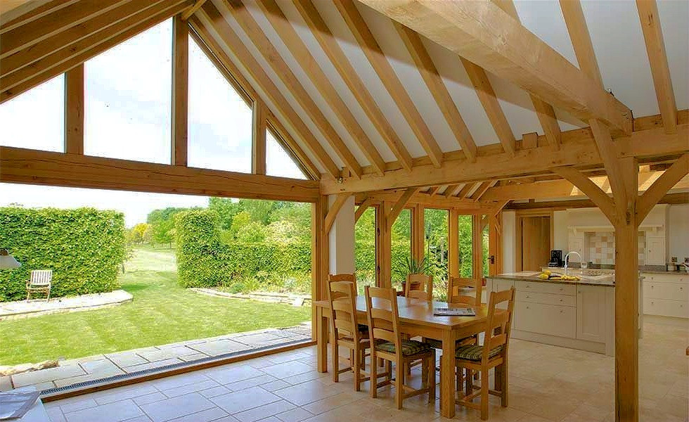 The interior of a timber frame extension opening up onto garden in a house in Cardiff, South Wales